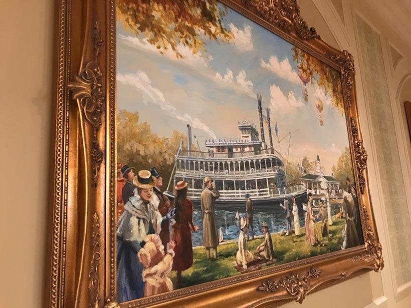 レセプションカウンターの壁にかけられている絵画の画像
